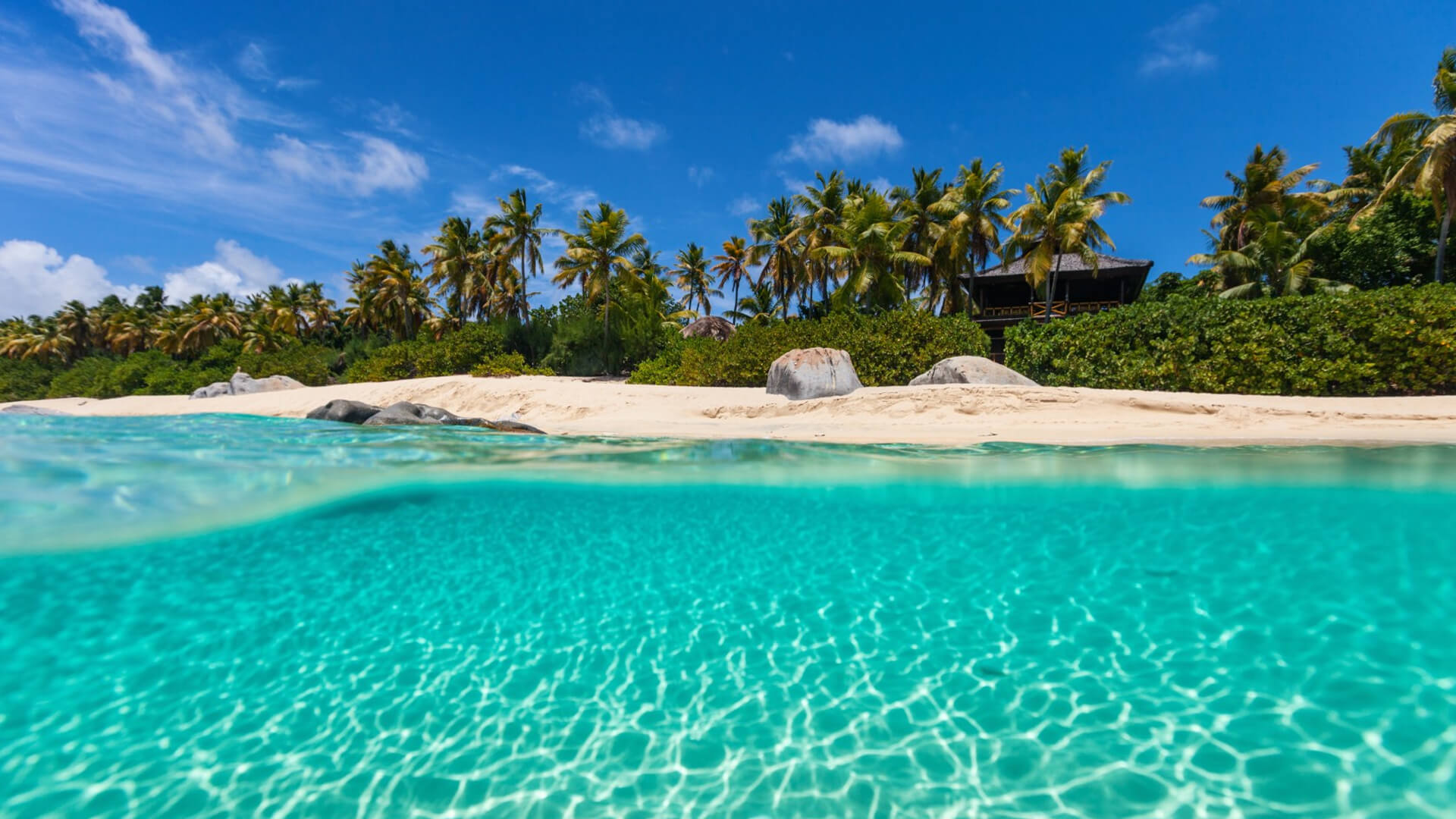 A selection of some of the idyllic destinations you can explore with Tropicalboat, such as the crystal waters of the Bahamas pictured above